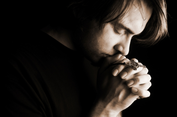 Man Praying Hands Folded